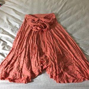 Strapless slinky flowy dress.